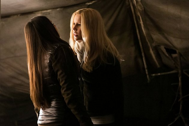 """Into the Wild"" -- Nina Dobrev as Elena (back to camera) and Claire Holt as Rebekah"