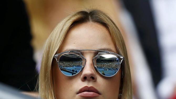 Ester Satorova, model and fiancee of Berdych of the Czech Republic watches as he plays against Nadal of Spain during their men's singles quarter-final match at the Australian Open 2015 tennis tournament in Melbourne