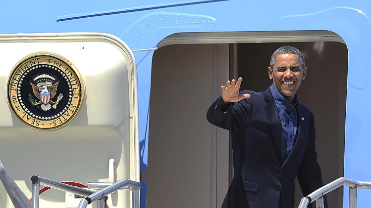 President Barack Obama waves to the media as he departs from Palm Springs International Airport in Palm Springs, Calif. on Sunday, June 9, 2013.(AP Photo/Rodrigo Pena)