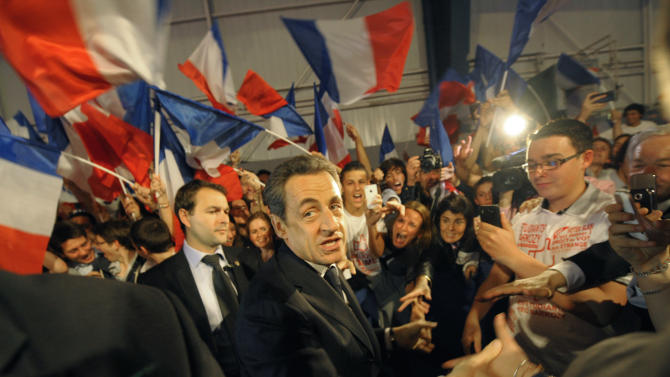 France's President and candidate for re-election in 2012, Nicolas Sarkozy, shakes hands as he arrives for a campaign meeting in Toulouse, western France, Sunday, April 29, 2012. (AP Photo/Philippe Wojazer, Pool)