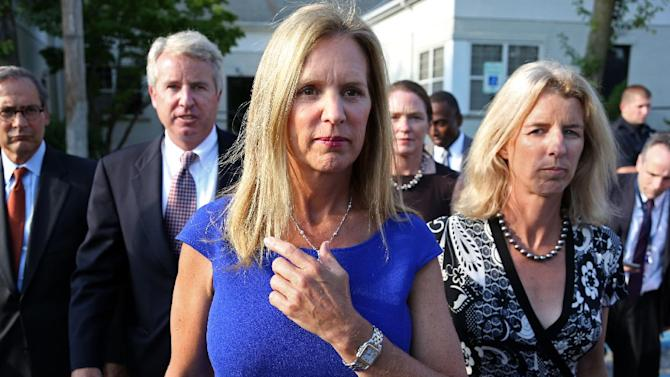 Kerry Kennedy, ex-wife of New York Gov. Andrew Cuomo, flanked by her brother Christopher Kennedy, second left, and sister Rory Kennedy, right, walks from the North Castle Justice Court in Armonk, N.Y. Tuesday, July 17, 2012. Kennedy was arrested Friday after state police said her Lexus struck a tractor-trailer on Interstate 684 north of New York City. Police said she drove the damaged car off the highway before it became disabled. (AP Photo/Craig Ruttle)