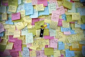 A yellow ribbon dedicated to missing and dead passengers of sunken passenger ship Sewol is seen among messages written for the victims outside the official memorial altar in Ansan