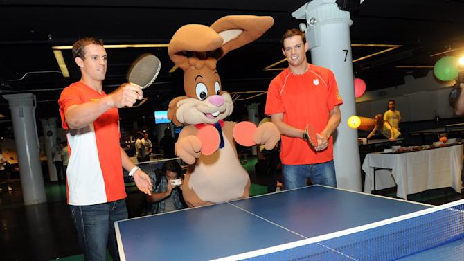 COMMERCIAL IMAGE - Gold medalists and champion tennis players Bob, right, and Mike Bryan join forces with the Nesquik Bunny before taking on FDNYís ace ping pong players at the Nesquik FDNY Foundation Charity Ping Pong tournament at SPiN Galactic in New York, Thursday, Aug. 23, 2012.  Nesquik donated $25,000 to the FDNY Foundation, supporting fire prevention and health and wellness programs.   (Diane Bondareff/Invision for Nesquik/AP Images)