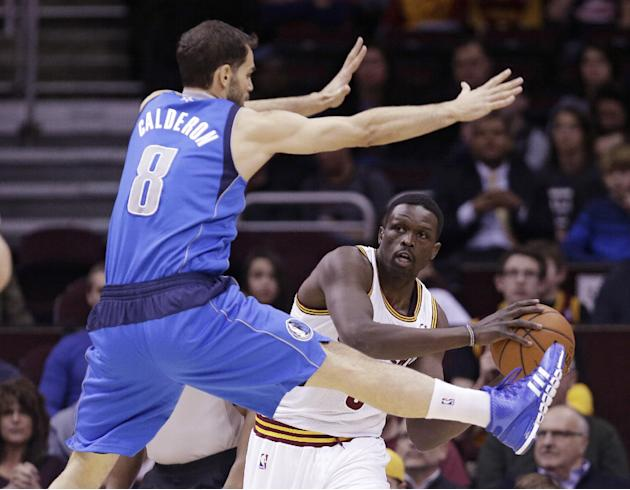 Cleveland Cavaliers' Loul Deng, right, from Sudan, looks for help under pressure from Dallas Mavericks' Jose Calderon, left, from Spain, during the first quarter of an NBA basketball game Mond