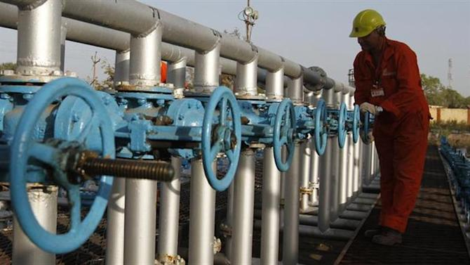 A technician opens a pressure gas valve inside the Oil and Natural Gas Corp (ONGC) group gathering station on the outskirts of Ahmedabad March 2, 2012. REUTERS/Amit Dave/Files
