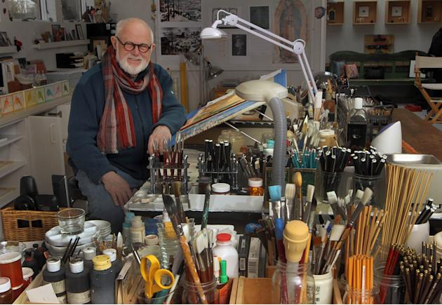 In this photo taken Sunday Dec. 1, 2013 children's author and illustrator Tomie dePaola poses with some of the tools of his trade in his studio in New London, N.H. For nearly 50 years dePaola has