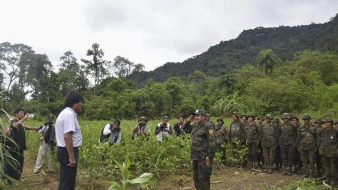 Bolivia's President Evo Morales receives a report from a member of the task forces on eradicating the illegal coca plants in Carrasco