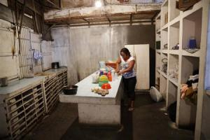 Fernanda Bolivar prepares food in the kitchen of the …