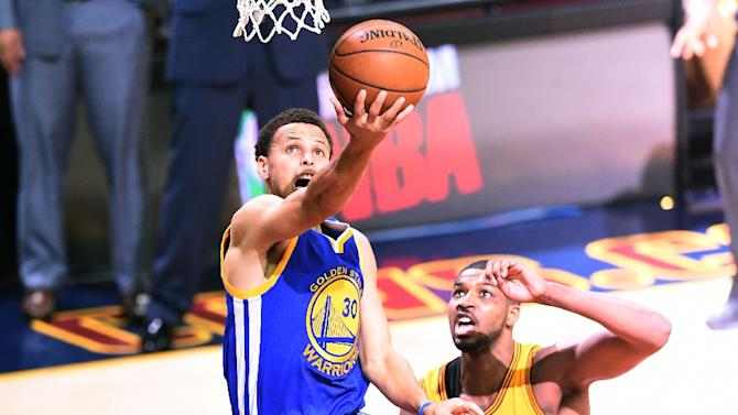 Stephen Curry (L) of the Golden State Warriors, pictured here in June, has pledged to win a second straight NBA title
