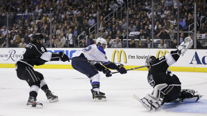 Los Angeles Kings goalie Jonathan Quick, right, stops a shot by St. Louis Blues' David Backes, center, as Kings' Drew Doughty watches during the first period in Game 3 of a first-round NHL hockey Stanley Cup playoff series n Los Angeles, Saturday, May 4, 2013. (AP Photo/Jae C. Hong)