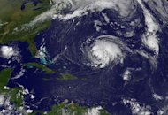 <p>This NASA satellite image shows Hurricane Michael (right) and Hurricane Leslie (centre) churning in the Atlantic Ocean. Michael has swelled to the first category three storm of 2012 as it churned far from land in the middle of the Atlantic, according to the Miami-based National Hurricane Center (NHC).</p>