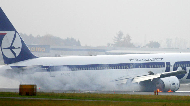 FILE - This Nov. 1, 2011 photo, a Boeing 767 of Polish LOT airlines with 231 people on board performs a successful emergency landing at the Frederic Chopin airport in Warsaw, Poland. Aviation experts on Tuesday, Oct. 31, 2012 said a LOT Polish Airlines flight from Newark, N.J. made an emergency landing in Warsaw last year because of technical problems with the Boeing 767 and inadequate guidance in its cockpit handbook. (AP Photo, File) POLAND OUT