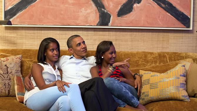 In this image released by the White House, President Barack Obama and his daughters, Malia, left, and Sasha, watch first lady Michelle Obama speak at the Democratic National Convention on television from the Treaty Room of the White House Tuesday, Sept. 4, 2012. (AP Photo/The White House, Pete Souza)