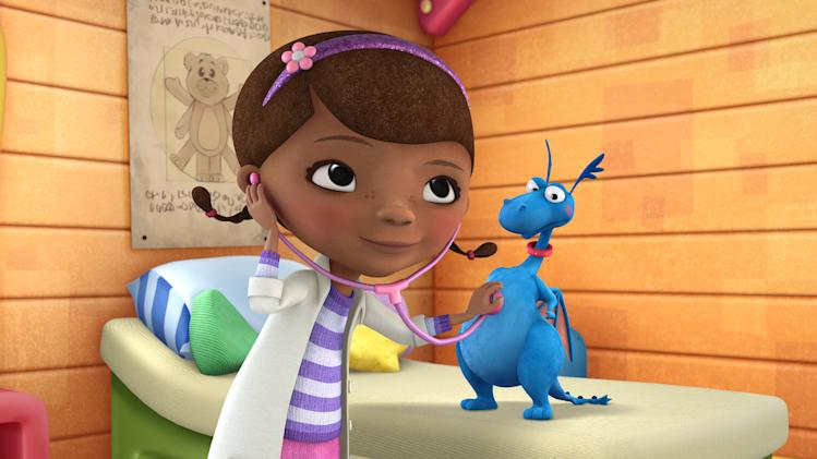 """FILE - This undated file image originally released by Disney Junior shows the character Doc McStuffins with Stuff in a scene from Disney Junior's animated series """"Doc McStuffins."""" The show is about a six-year-old girl who runs and operates a clinic for broken toys and worn out stuffed animals out of the playhouse in her backyard. (AP Photo/Disney Junior, file)"""