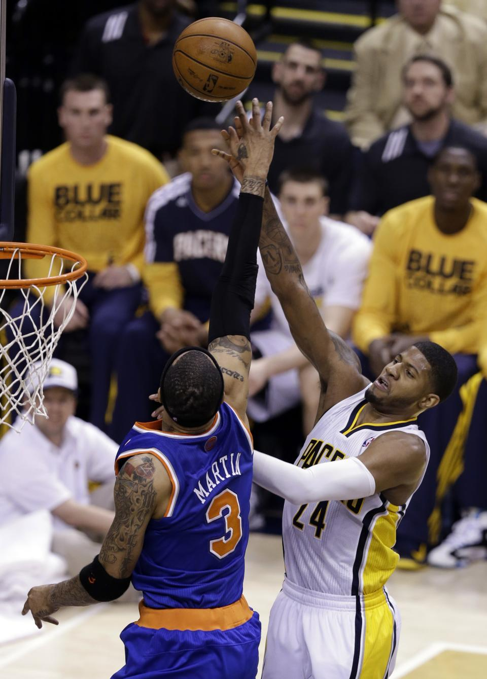Indiana Pacers forward Paul George, right, shoots over New York Knicks forward Kenyon Martin during the first half of Game 4 of the Eastern Conference semifinal NBA basketball playoff series, in Indianapolis on Tuesday, May 14, 2013. (AP Photo/Michael Conroy)