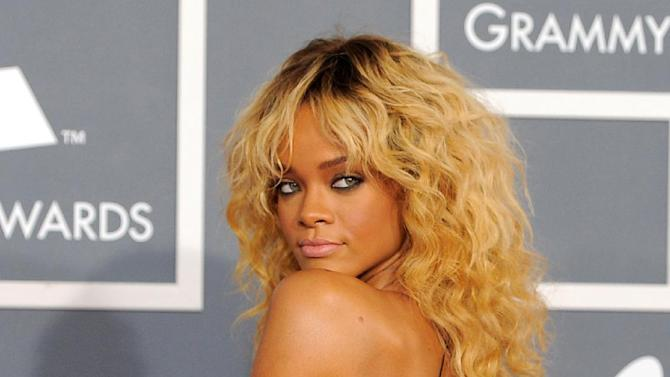 "FILE - This Feb. 12, 2012 file photo shows Rihanna at the 54th annual Grammy Awards in Los Angeles. CBS has issued a memo to Grammy Awards attendees against baring too much skin at the ceremony Sunday. The network requests that ""buttocks and female breasts are adequately covered"" for the televised award show. The memo sent out Wednesday, Feb. 6, 2013, also warned against ""see-through clothing,"" exposure of ""the genital region"" and said that ""thong type costumes are problematic."" (AP Photo/Chris Pizzello, file)"