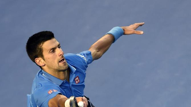 Novak Djokovic of Serbia reaches out for a shot to Stan Wawrinka of Switzerland during their semifinal at the Australian Open tennis championship in Melbourne, Australia, Friday, Jan. 30, 2015. (AP Photo/Andy Brownbill)