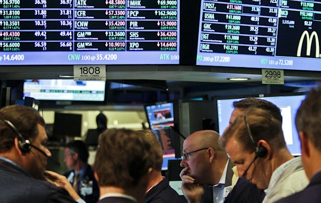 FILE- In a July 13, 2012, file photo, traders work as the New York Stock Exchange nears closing. JPMorgan Chase blew away a cloud of concern hanging over the banking industry Friday and set off a rally in stocks. (AP Photo/Bebeto Matthews)