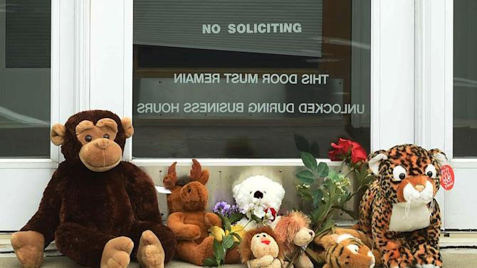 """Stuffed animals adorn the doorstep of Dr. Walter Palmer's River Bluff Dental office in Bloomington, Minn., Tuesday, July 28, 2015. Palmer, accused of illegally killing a protected lion in Zimbabwe, said Tuesday that he thought everything about his trip was legal and wasn't aware of the animal's status """"until the end of the hunt."""" (Scott Takushi/Pioneer Press via AP)"""