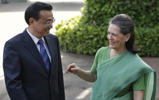 File photo of Chinese Premier Li speaking with Gandhi, chief of India's ruling Congress party, before their meeting in New Delhi