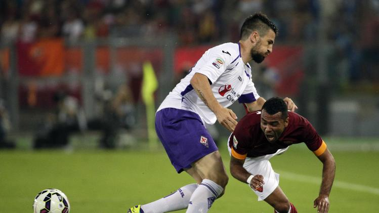 AS Roma's Ashley Cole is tackled by Fiorentina's Nenad Tomovic during their Italian Serie A soccer match at the Olympic stadium in Rome