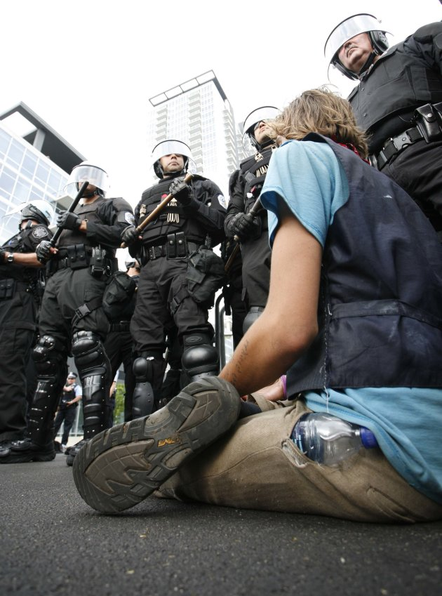Chicago Police use batons in an attempt to clear out protestors marching through downtown Chicago during an anti-NATO protest march