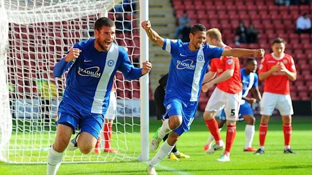 Michael Bostwick scores Peterborough's second in the 2-2 draw at Crewe