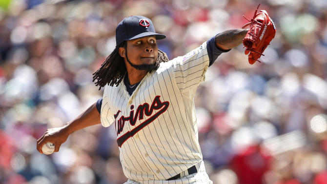 Minnesota Twins starting pitcher Ervin Santana delivers to the Pittsburgh Pirates in the fifth inning of a baseball game Wednesday, July 29, 2015, in Minneapolis. The Pirates won 10-4. (AP Photo/Bruce Kluckhohn)