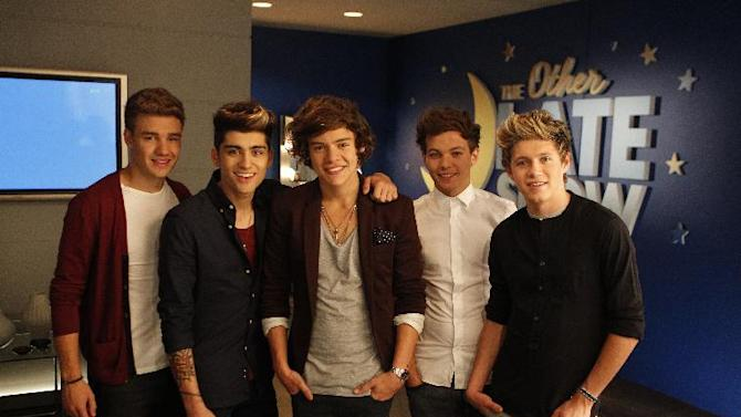 """This Sept. 2, 2012 photo shows the music group One Direction, from left, Liam Payne, Zayn Malik, Harry Styles, Louis Tomlinson and Niall Horan during the taping of a Pepsi commercial in New Orleans. The soda company is partnering with the boy band and New Orleans Saints quarterback Drew Brees for an ad that will debut Wednesday. It's part of Pepsi's """"Live for Now"""" campaign, which has also featured Nicki Minaj and Katy Perry. (Photo by William Haber/Invision/AP)"""