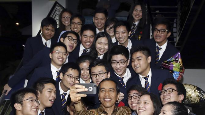 File photo of Indonesia President Jokowi taking a selfie with son at graduation in Singapore