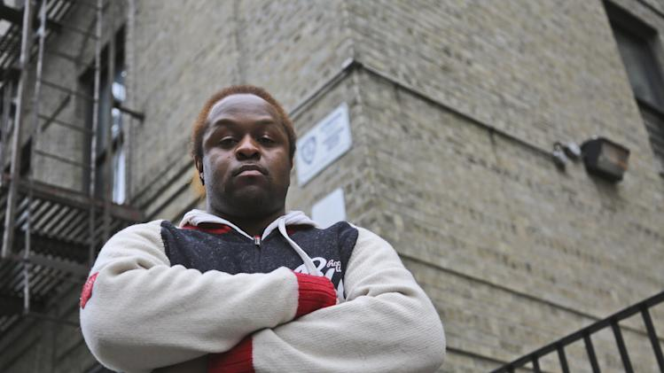 """In this Wednesday, March 6 2013 photo,  Abdullah Turner poses for a photo outside his building in the Bronx borough of New York.   Turner lives in one of thousands of private dwellings patrolled by the New York Police Department under a program known as """"Operation Clean Halls."""" (AP Photo/Mary Altaffer)"""