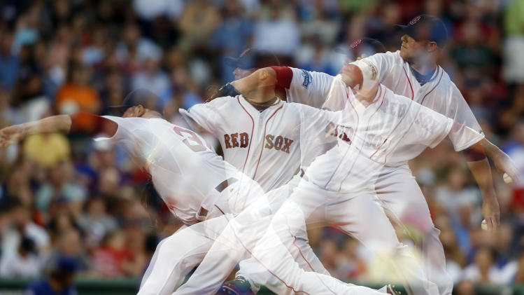 FILE - In this Tuesday, Aug. 7, 2012 file photo made with a multiple exposure, Boston Red Sox's Jon Lester pitches in the third inning of a baseball game against the Texas Rangers in Boston. A new study suggests the ability to throw hard and accurately first appeared in a human ancestor 2 million years ago. (AP Photo/Michael Dwyer, File)