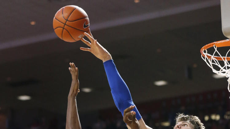 Kansas center Jeff Withey blocks a shot by Oklahoma forward Andrew Fitzgerald (4) during the second half of an NCAA college basketball game in Norman, Okla., Saturday, Feb. 9, 2013. Oklahoma won 72-66. (AP Photo/Sue Ogrocki)