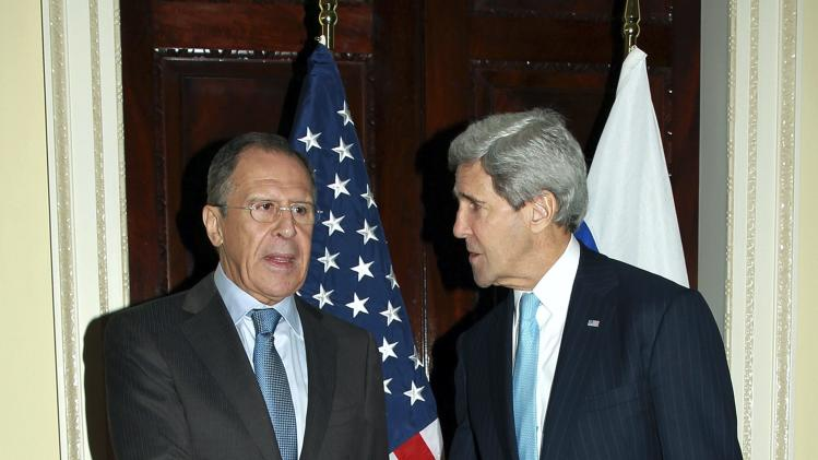 U.S. Secretary of State John Kerry shakes hands with Russia's Foreign Minister Sergei Lavrov during their meeting at the home of the U.S. ambassador in London