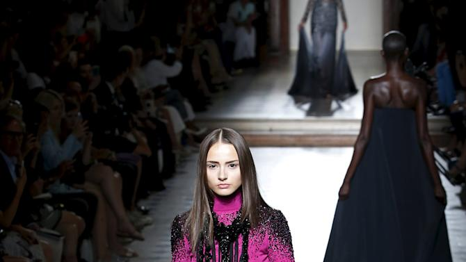 A model presents a creation by French designer Julien Fournie as part of his Haute Couture Fall Winter 2015/2016 fashion show in Paris