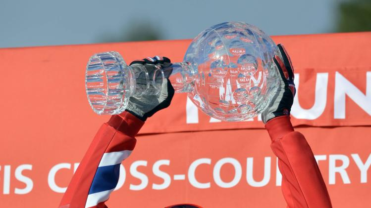 The overall winner Petter Northug of Norway holds the trophy as he celebrates on the podium after the FIS Cross Country World Cup Final in Falun, Sweden, Sunday March 24, 2013.  (AP Photo/Scanpix Sweden/Anders Wiklund) SWEDEN OUT