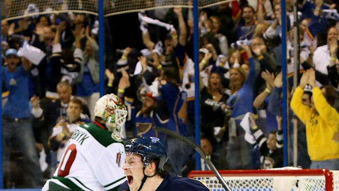 St. Louis Blues right wing Vladimir Tarasenko reacts after scoring his first of two goals in the first period during a first-round hockey playoff game between the St. Louis Blues and the Minnesota Wild on Saturday, April 18, 2015, at the Scottrade Center in St. Louis.  At left is Minnesota Wild goaltender Devan Dubnyk. (Chris Lee/St. Louis Post-Dispatch via AP)  EDWARDSVILLE INTELLIGENCER OUT; THE ALTON TELEGRAPH OUT; MANDATORY CREDIT