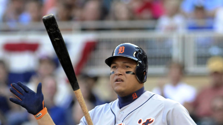 Detroit Tigers' Miguel Cabrera tosses his bat after striking out swinging in the first inning off Minnesota Twins pitcher P.J. Walters in a baseball game Saturday, Sept. 29, 2012 in Minneapolis. (AP Photo/Jim Mone)