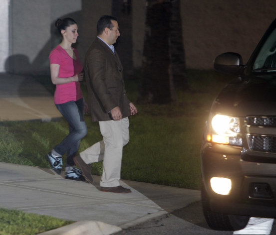 Casey Anthony, left, walks to a SUV with her lawyer Jose Baez after she was released from the Orange County Jail in Orlando, Fla., early Sunday, July 17, 2011. Anthony was acquitted last week of murder in the death of her daughter, Caylee. (AP Photo/John Raoux)