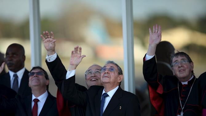 Cuba's President Raul Castro (C), waves at the airplane of Pope Francis after he departed from Jose Marti International Airport in Havana