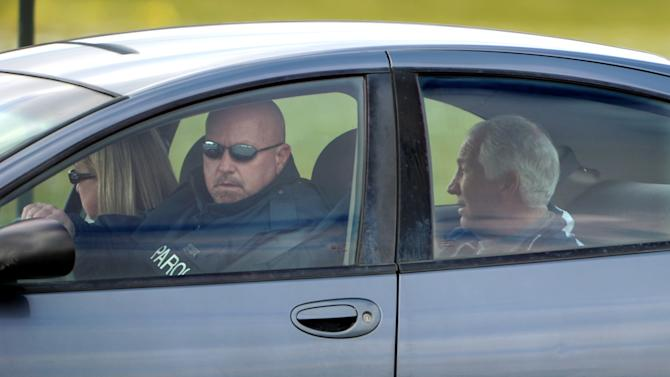 A Parole Officer drives Jerry Sandusky to his State College, Pa. home, on Thursday, Dec. 8, 2011 after Sandusky posted bail.   The former Penn State assistant football coach was released from jail Thursday after spending a night behind bars following a new round of child sex abuse charges filed against him.  Sandusky secured his release using $200,000 in real estate holdings and a $50,000 certified check provided by his wife, Dorothy, according to online court records.  (AP Photo/Centre Daily Times, Nabil K. Mark)  ALTOONA MIRROR OUT , MAGS OUT, NO SALES