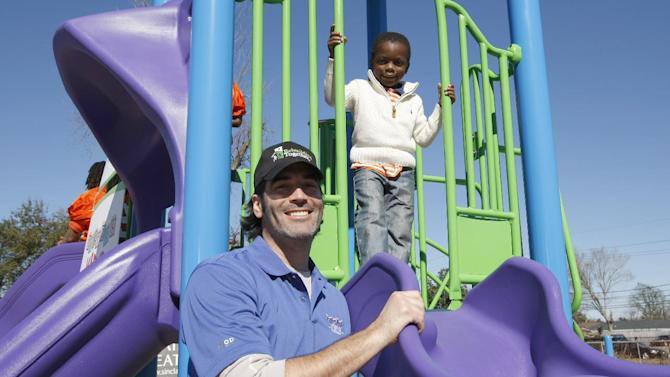 IMAGE DISTRIBUTED FOR REBUILDING TOGETHER - Kickoff to Rebuild, the Super Bowl Charity event with Rebuilding Together, Lowe's and Carter Oosterhouse from HGTV and Carter's Kids completes a playground on the corner of Corner of DeArmas Street & Odeon Avenue in New Orleans, Louisiana on Friday, Feb. 1, 2013. (Scott Boehm / AP Images for Rebuilding Together)
