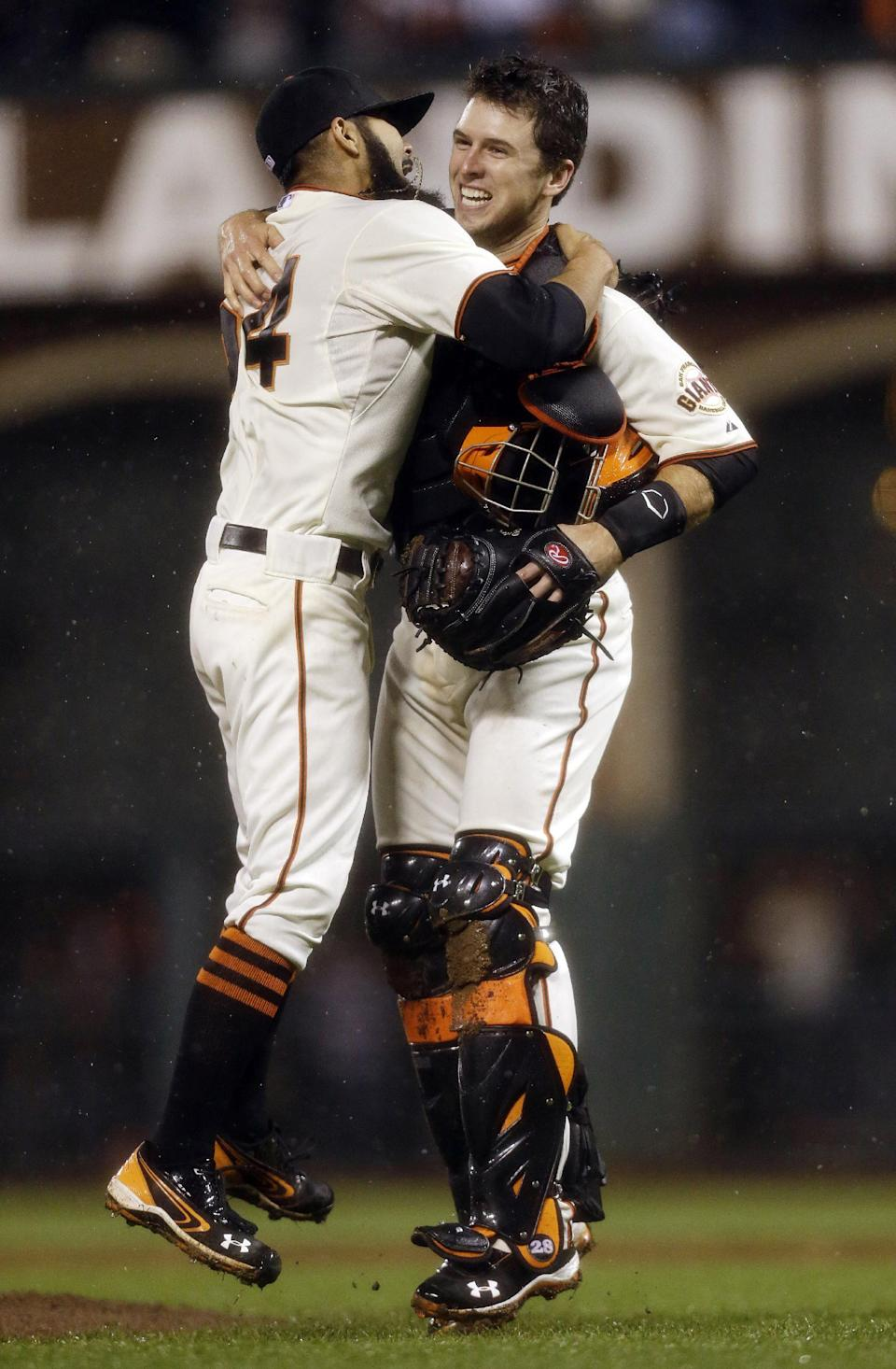 San Francisco Giants relief pitcher Sergio Romo and catcher Buster Posey react after the final out in Game 7 of baseball's National League championship series against the St. Louis Cardinals Monday, Oct. 22, 2012, in San Francisco. The Giants won 9-0 to win the series. (AP Photo/Ben Margot)