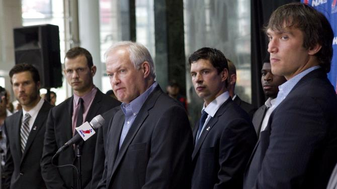 Donald Fehr, center, executive director of the NHL Players' Association, stands with players, from left, Chicago Blackhawks' Steve Montador, Ottawa Senators' Jason Spezza, Pittsburgh Penguins' Sidney Crosby and Washington Capitals' Alex Ovechkin as he speaks to reporters following collective bargaining talks in Toronto on Tuesday, Aug. 14, 2012. (AP Photo/The Canadian Press, Chris Young)