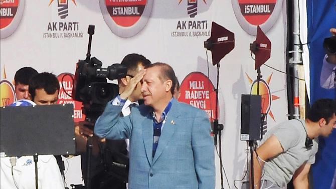 Turkish Prime Minister Recep Tayyip Erdogan salutes supporters during a party rally in Istanbul, Turkey, Sunday, June 16, 2013.(AP Photo/Burhan Ozbilici)