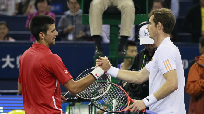 Novak Djokovic of Serbia, left, and Andy Murray of Britain, right, shake hands after their men's singles match at the Shanghai Masters tennis tournament at Qizhong Forest Sports City Tennis Center in Shanghai, China, Sunday Oct. 14, 2012.  Djokovic won 5-7, 7-6(11), 6-3. (AP Photo/Eugene Hoshiko)