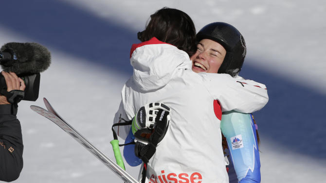 Slovenia's Tina Maze, right, and Switzerland's Dominique Gisin embrace after finishing the women's downhill at the Sochi 2014 Winter Olympics, Wednesday, Feb. 12, 2014, in Krasnaya Polyana, Russia. (AP Photo/Gero Breloer)