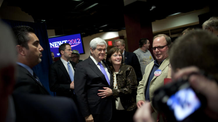 Republican presidential candidate, former House Speaker Newt Gingrich takes photographs during a campaign stop at the Jim Thorpe Museum on Monday, Feb. 20, 2012 in Oklahoma City, Okla.  (AP Photo/Evan Vucci)