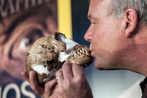 Professor Lee Berger kisses a replica of the skull …
