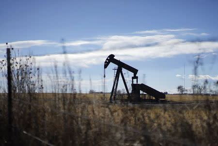 Brent dips, holds above $60 after Saudi price increases